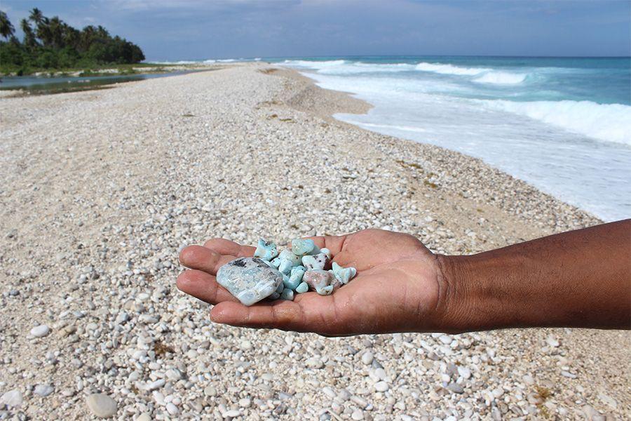 Ocean beach in the Dominican Republic. Raw Larimar stones are found on the shore.