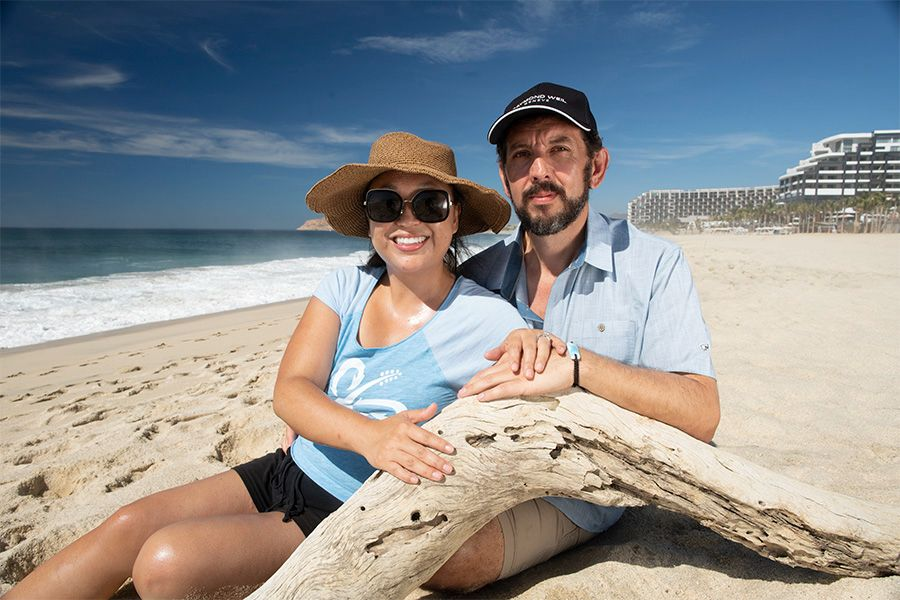 Adrian Nixon sitting on the beach with his wife in the DR, where he discovered the Larimar gemstone.